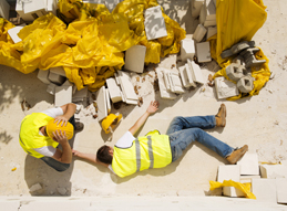 Image of an injured construction worker laying on ground