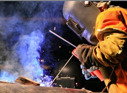 Image of a construction worker welding a piece of metal together