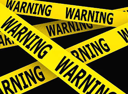 Image of bright yellow warning sign parameter do not cross tape