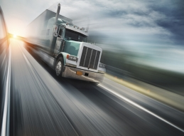 Picture of big rig truck driving down highway